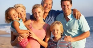 family_beach_holiday_parents_children_grandparents_0
